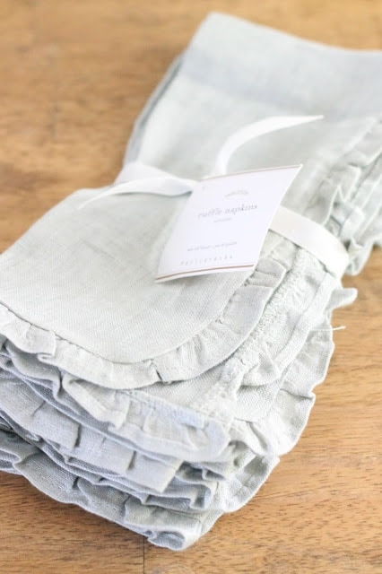 Linen napkins on a wood surface.