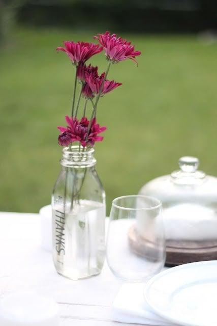 Pink flowers in a mason jar vase.