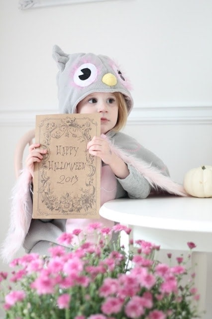 A little girl holding a printable