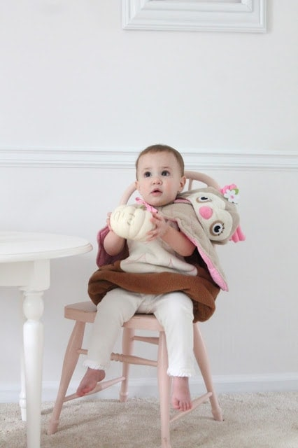 A baby sitting in a chair