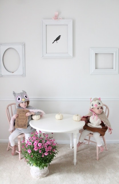 Two girls dressed up sitting at a table