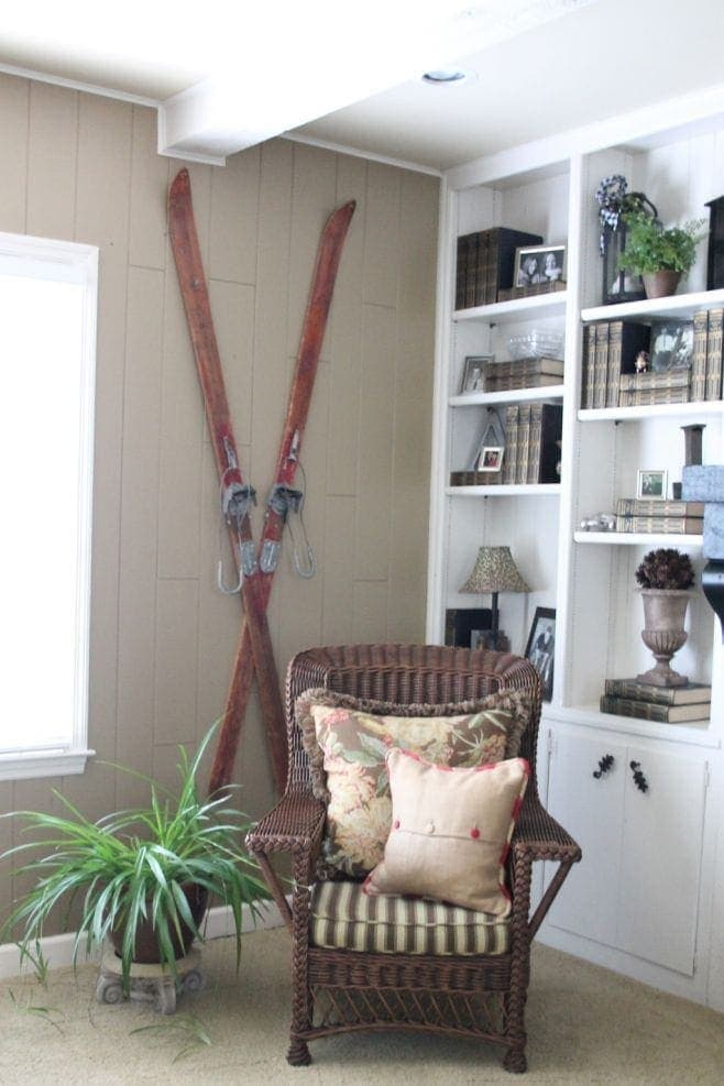 beautifully styled bookcases and antique skis