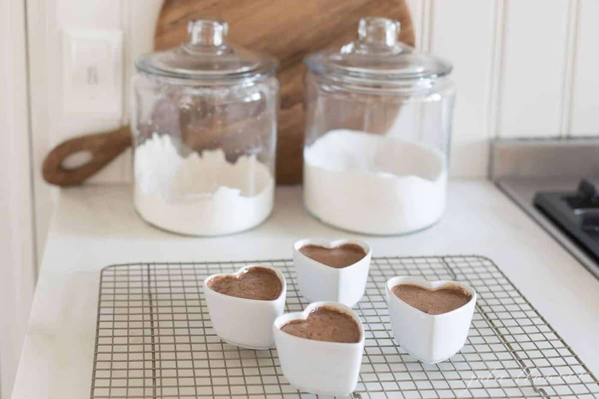 pots de creme in front of jars of sugar and flour
