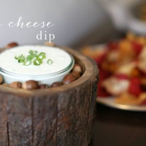 blue cheese dip in a clear bowl with chips on the side