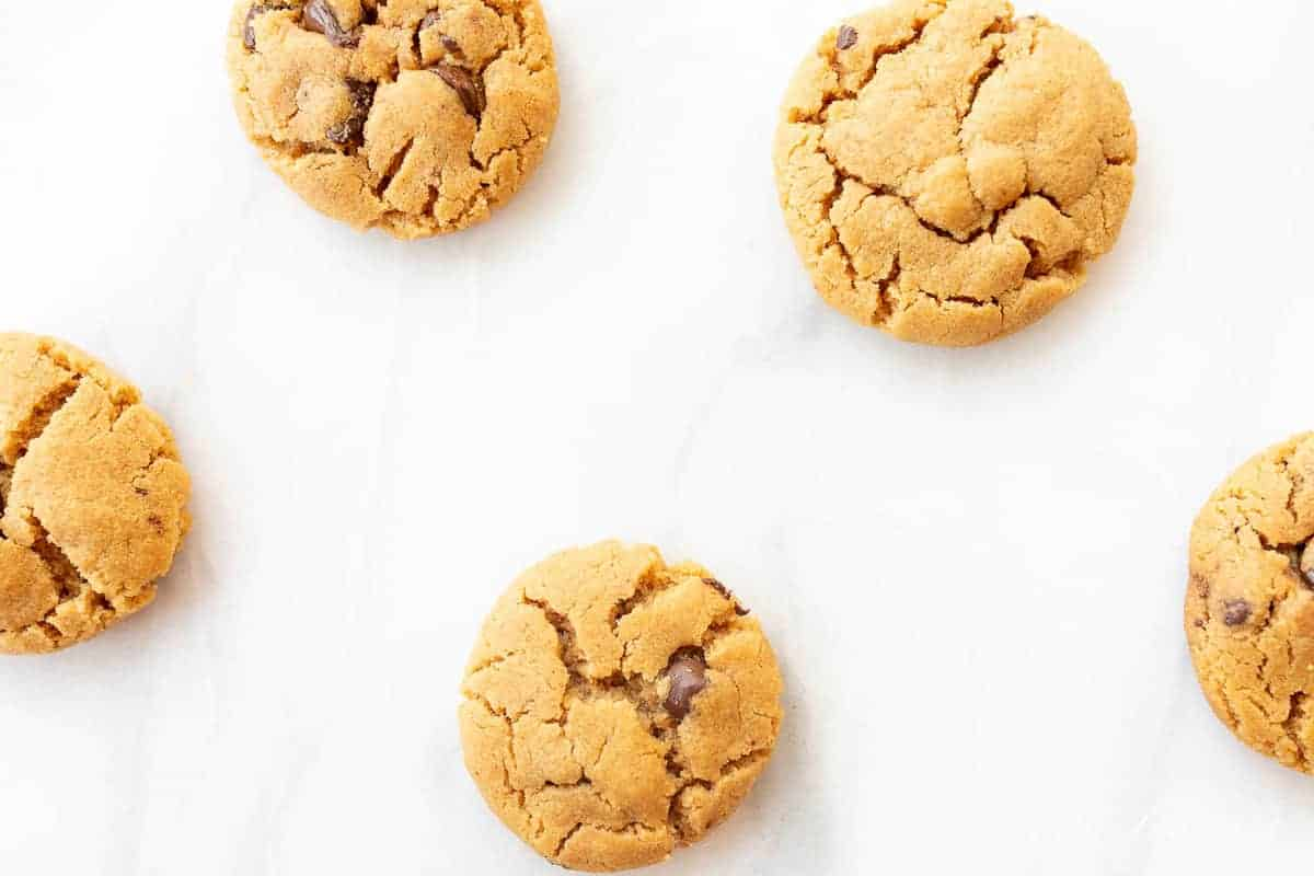 flourless peanut butter chocolate chip cookies on marble counter