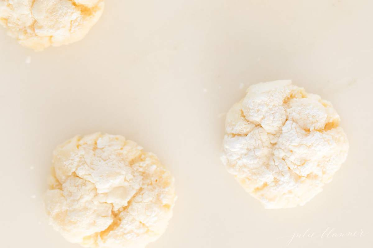 Three gooey butter cookies on a white surface