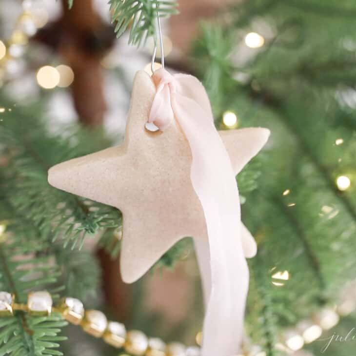 salt dough ornament on tree with pink ribbon