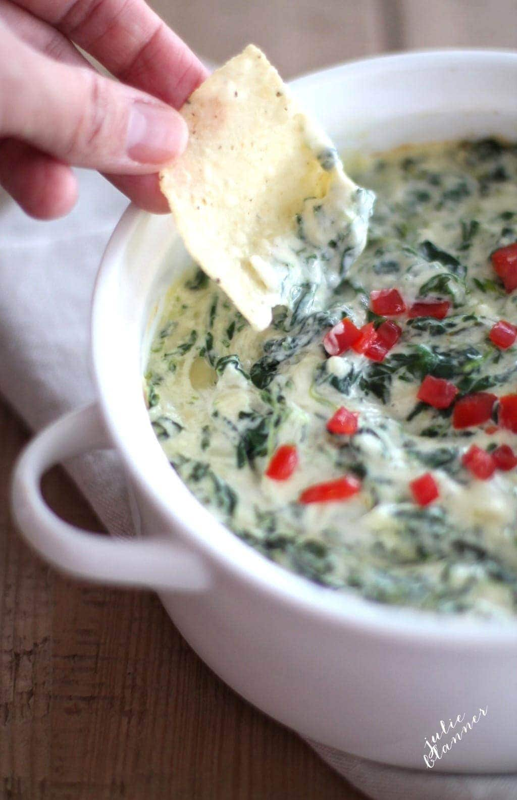 Easy, creamy spinach dip in just 10 minutes! Get the recipe for this fabulous make ahead appetizer. Perfect for holiday entertaining!
