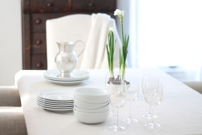 neutral winter table setting with potted paperwhites
