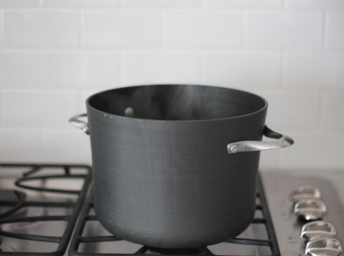 black pot of boiling water on gas stovetop