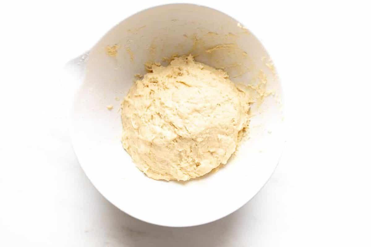 Belgian waffle dough in a white bowl.