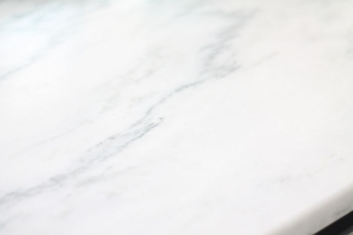 A close up of a marble countertop used in a kitchen makeover on a budget.