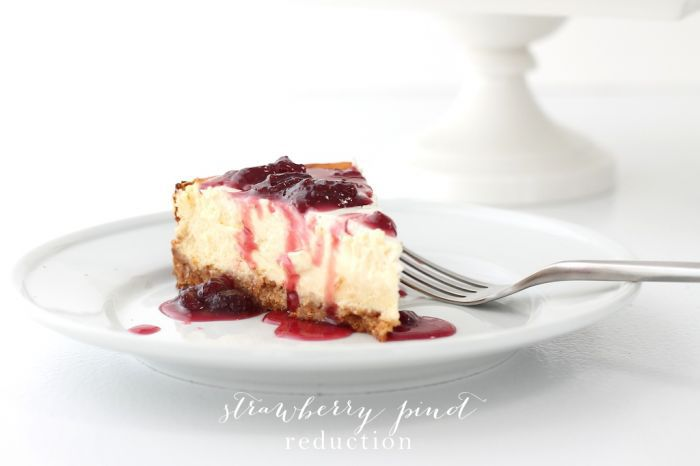 A slice of cheesecake with a pinot and strawberry topping