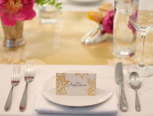 A fake calligraphy name tag on top of a white plate.