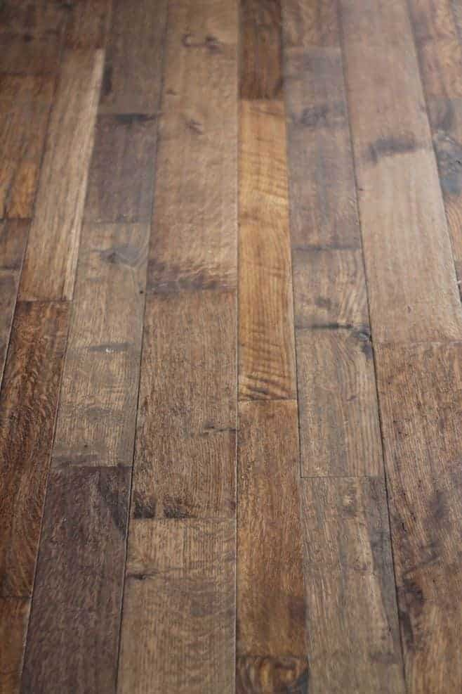 A rustic wood floor in farmhouse kitchen ideas on a budget.