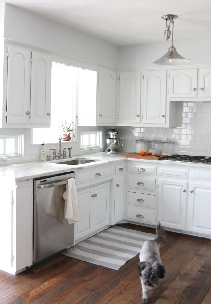 classic white kitchen with stainless steel appliances