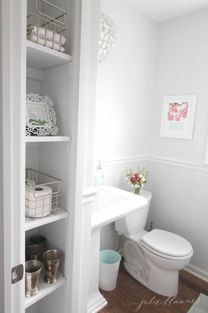 See the before and after of this DIY half bath on a budget filled with tips for a small bathroom
