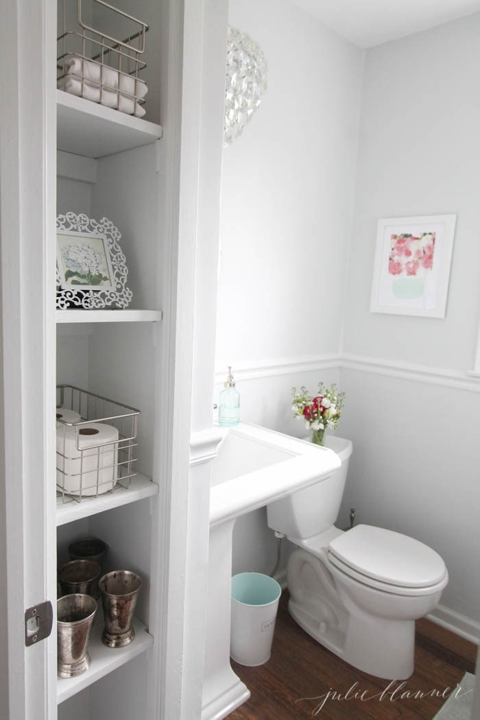 Small bathroom storage ideas - how to open up the space to add light & function