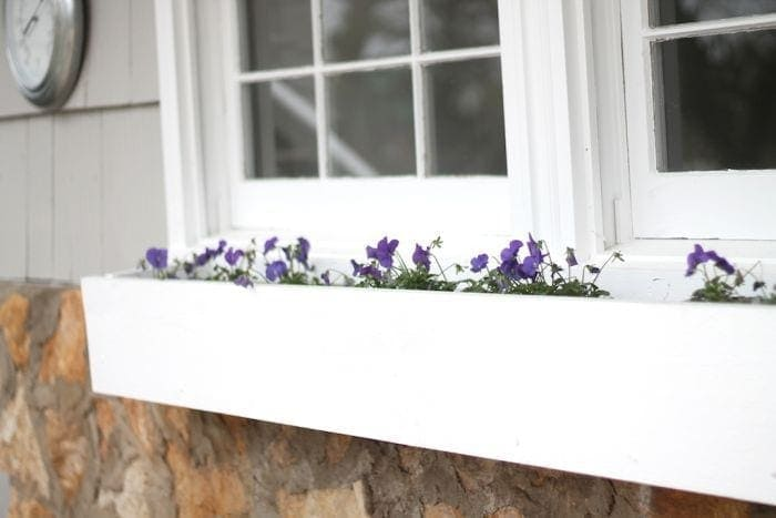 window planter boxes add charm to a patio