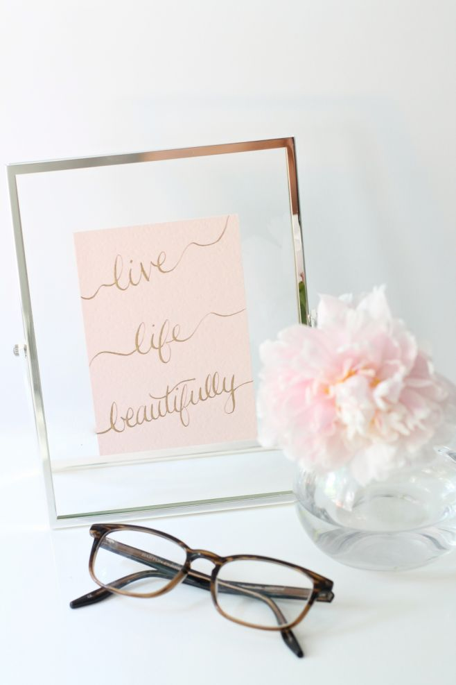 """Live life beautifully"" beauty quote in calligraphy"