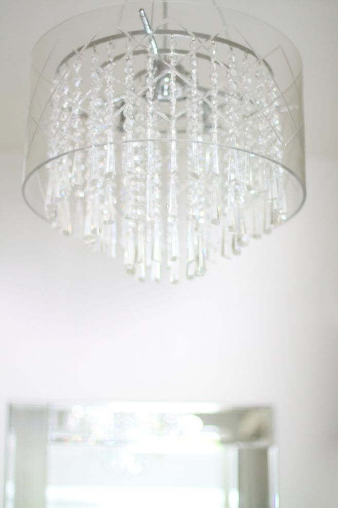 gorgeous etched glass & crystal chandelier in a walk-in closet