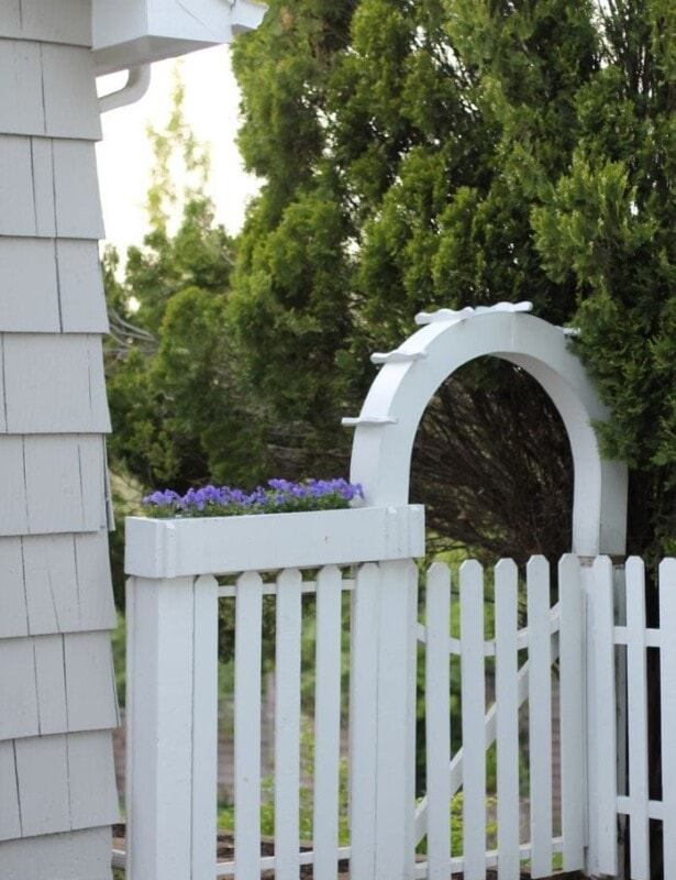 white picket garden entrance and planter box