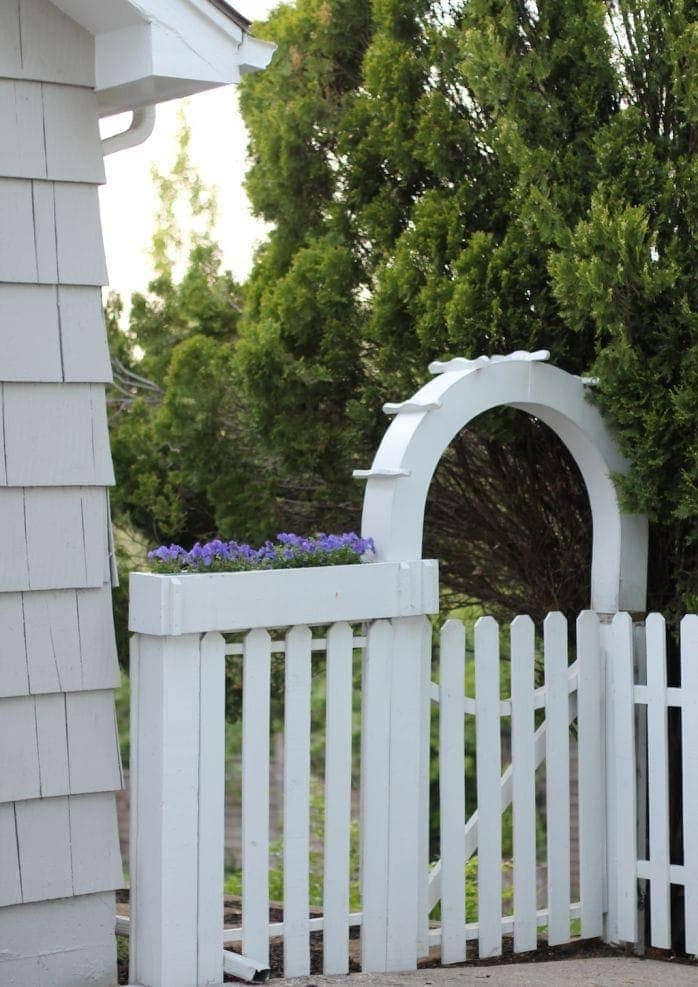 white picket garden entrance and planter box