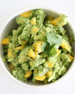 Mango Guacamole is fresh & flavorful as a dip or an accompaniment to chicken, enchiladas, & quesadillas. Get the recipe at julieblanner.com