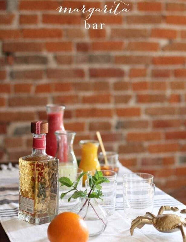 Create a margarita bar for guests to customize their concoctions