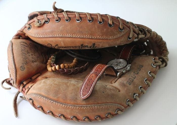 Family heirlooms - even old baseball gloves style a man's closet with functionality
