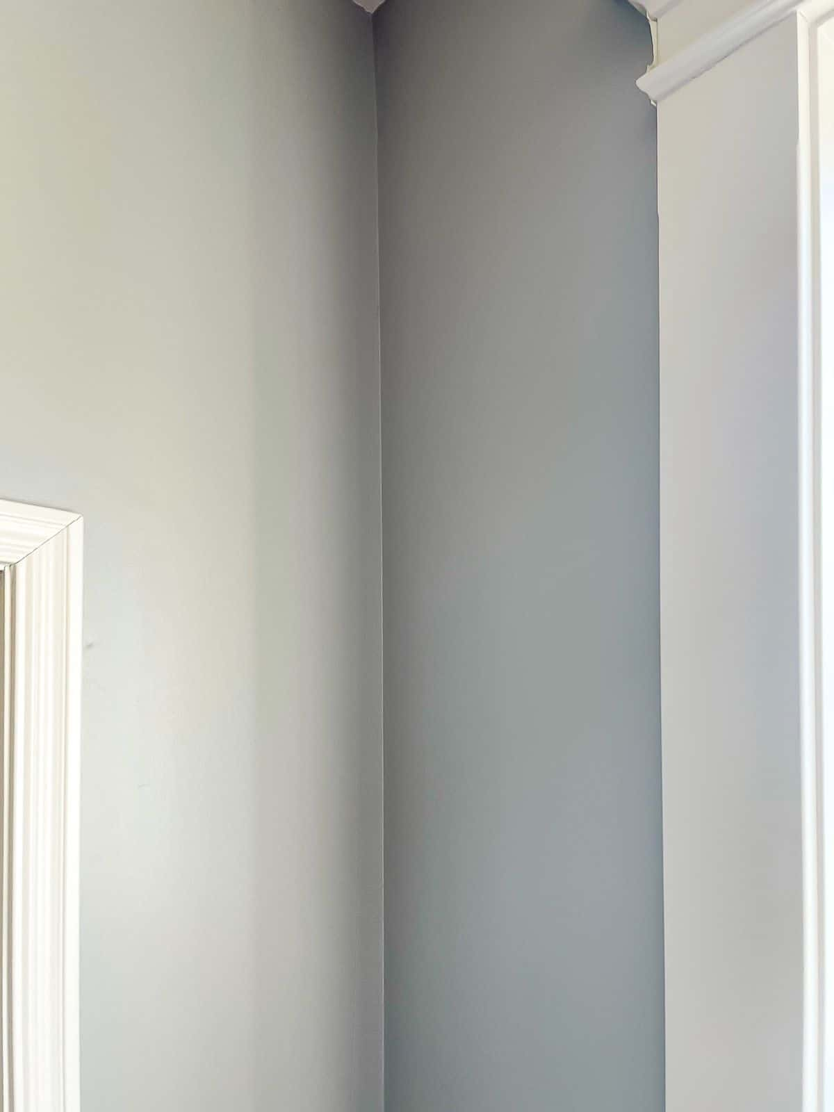 SW 7036 on the trim with a deeper blue gray color on surrounding walls.