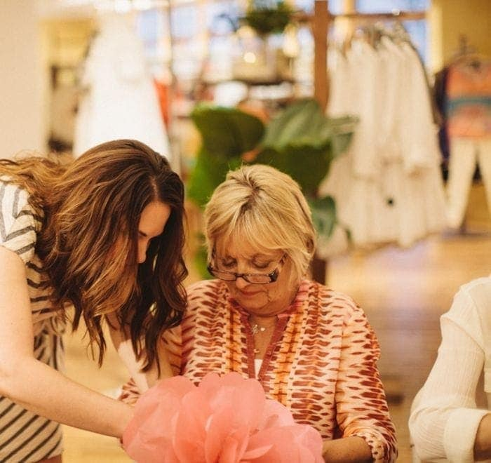 blogger Julie Blanner leads AnthroEvents attendees creating giant paper flowers