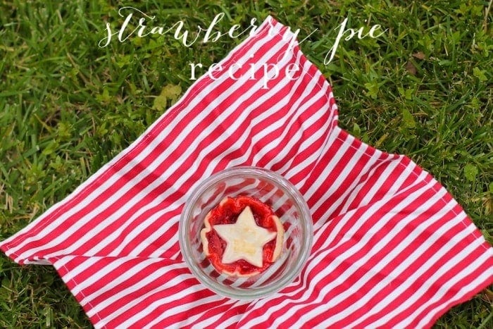 A strawberry pie in a glass bowl with text overlay