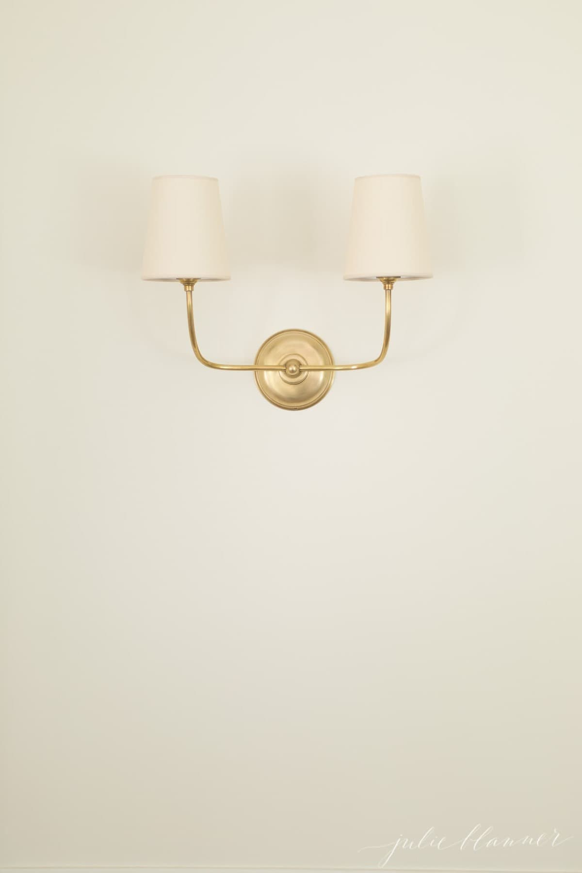 A gold wall lamp.