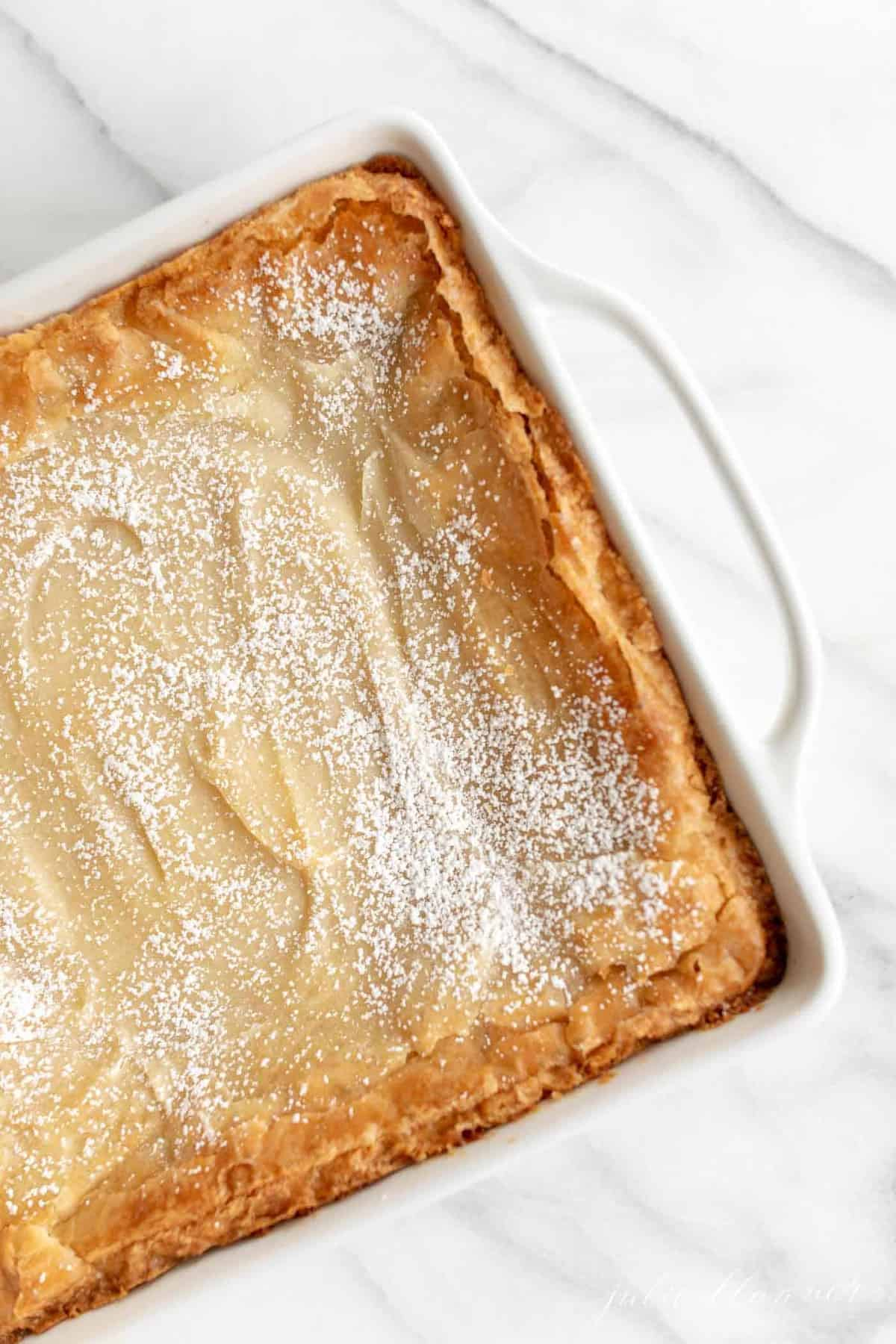 gooey butter cake with brown butter in white baking dish