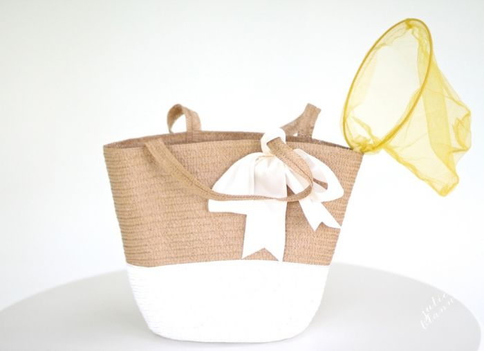 A basket with basic outdoor children\'s toys inside.
