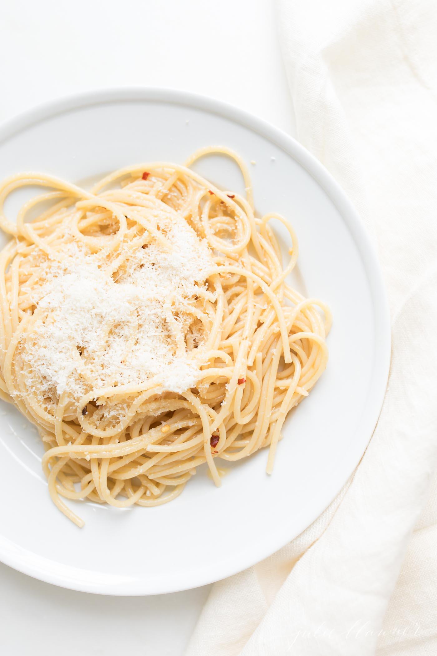 pasta aglio e olio on white plate