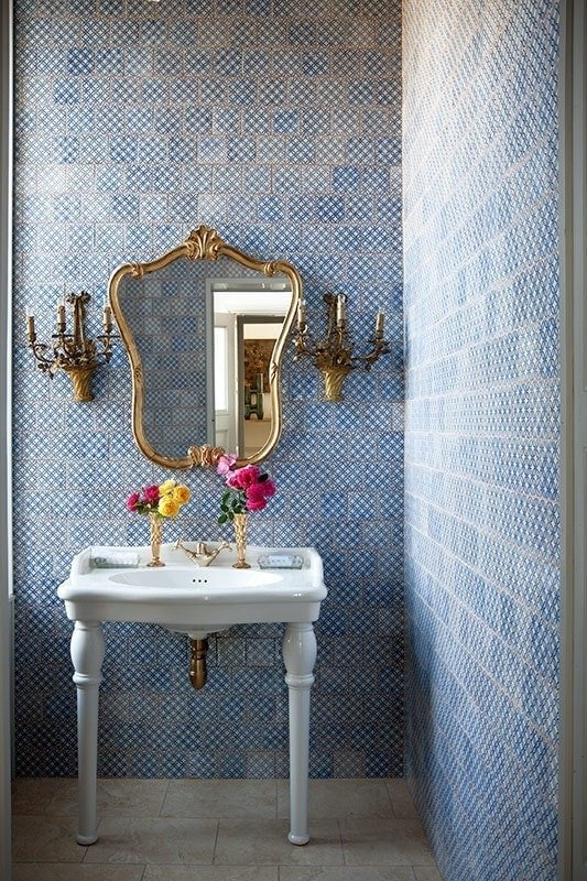Beautiful sink & ornate brass mirror for a half bathroom