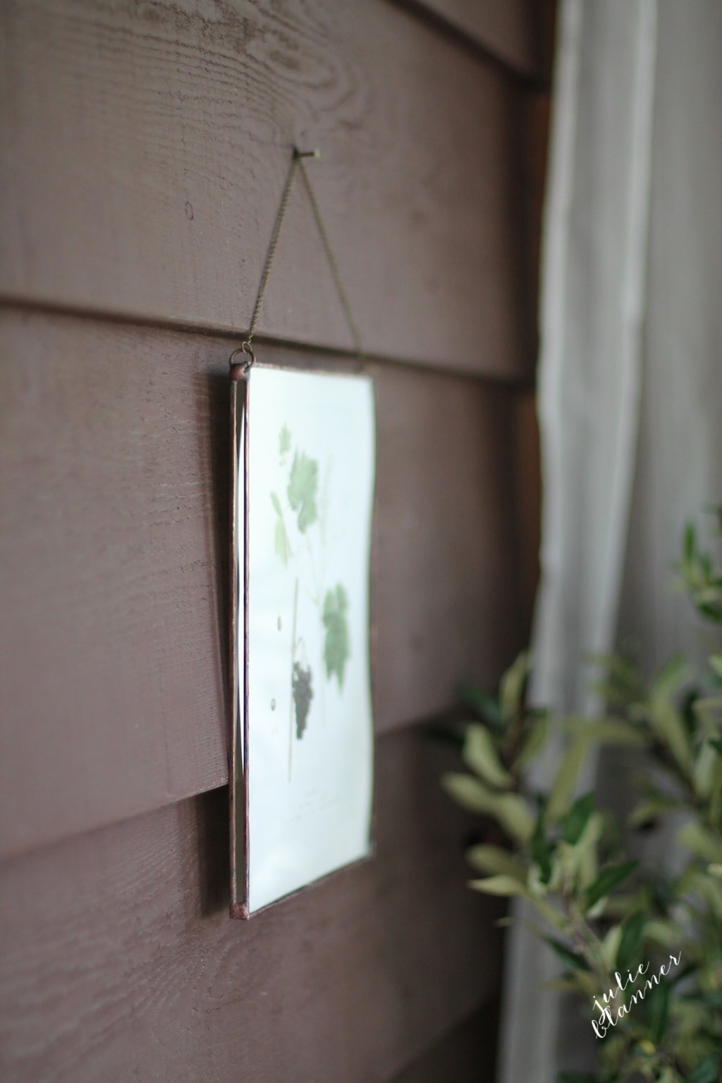 Decorate an outdoor space to make it feel like an extension of your home. Beautiful copper frame by Copper & Torch