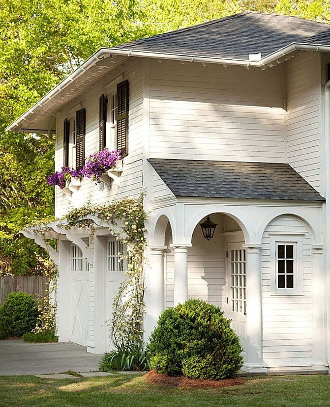 Gorgeous home exterior with window boxes, verandas & pergolas