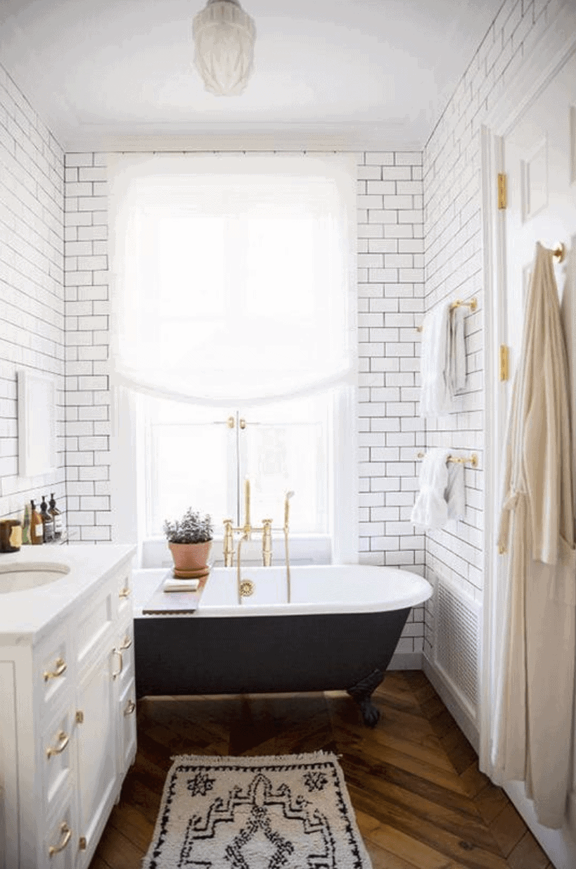 Beautiful bathroom with claw foot tub & subway tiled walls
