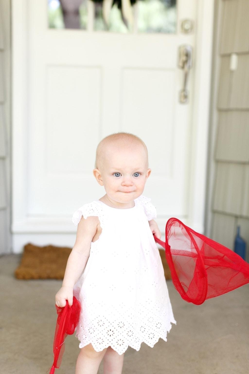 A little girl holding a net