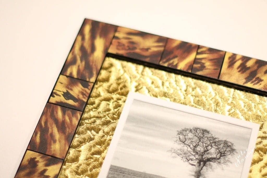 Update a picture frame with decoupage & metallic tape to get the look for less.