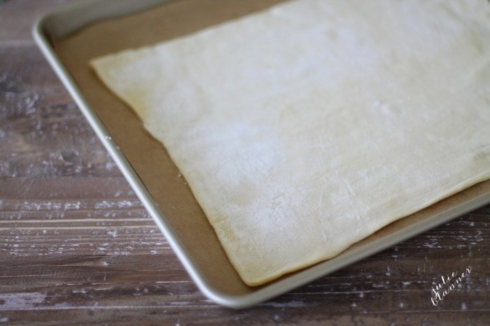 Parchment and puff pastry on a baking sheet