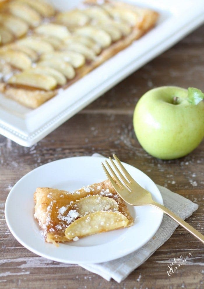 Baked apple tart sprinkled with powdered sugar