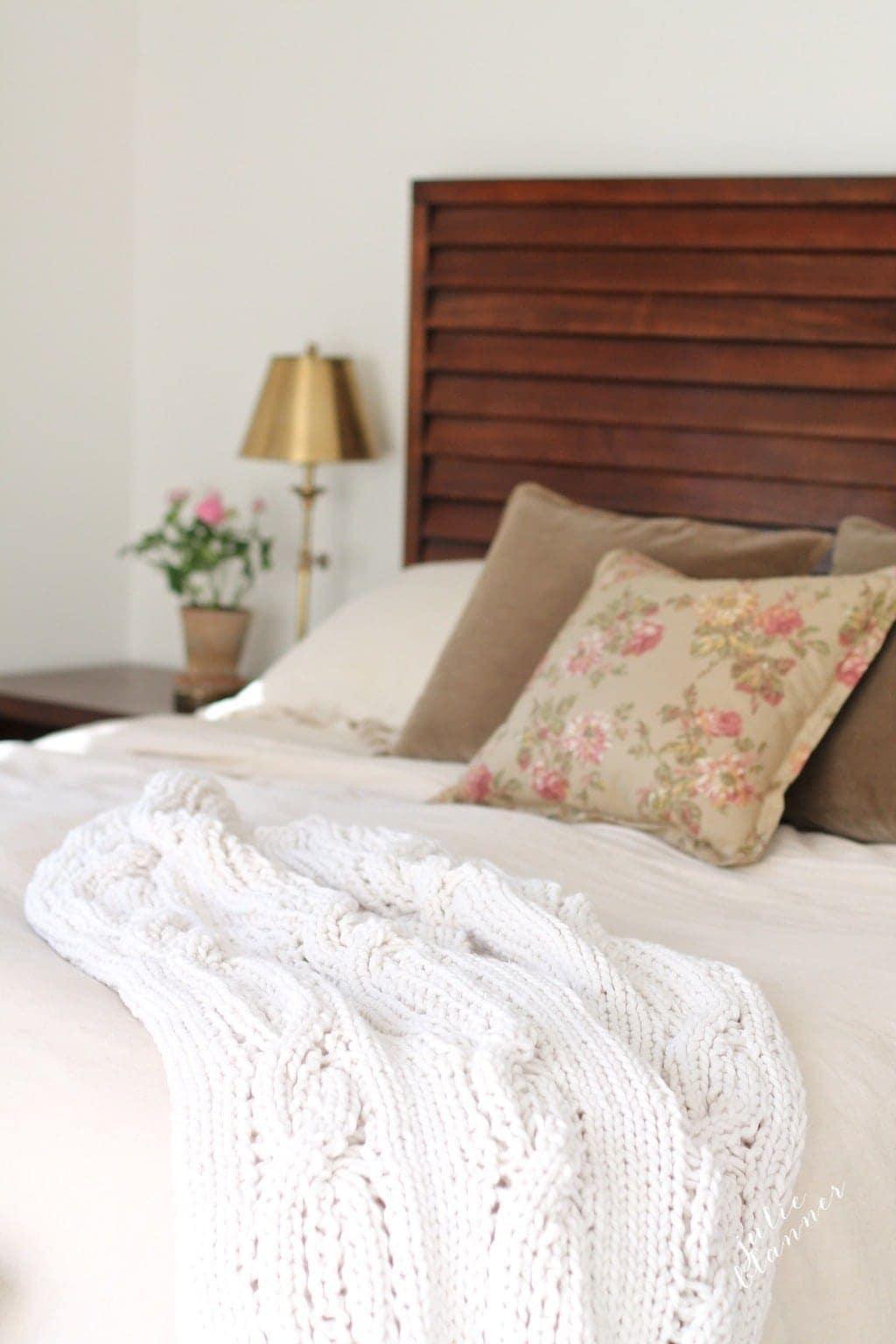 master bedroom vignette - a chunky throw, velvet pillows & linen duvet for lots of texture