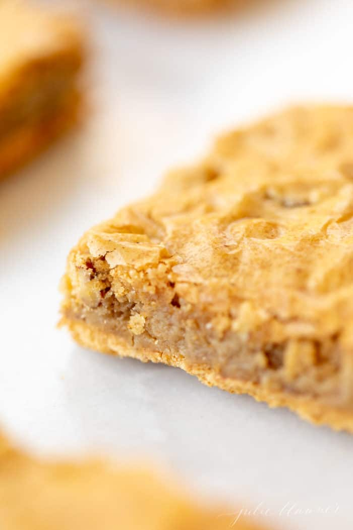 easy salted caramel pecan pie bar on white surface