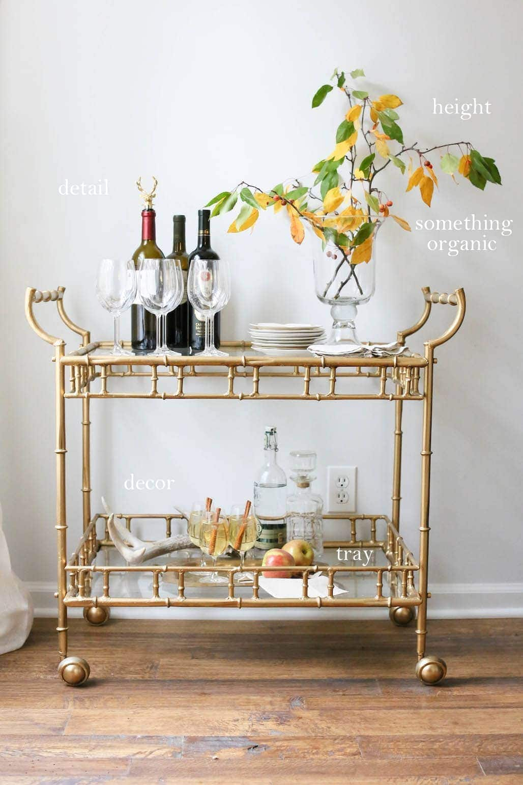 A styled and functional bar cart needs details, heigh, something organic and decor