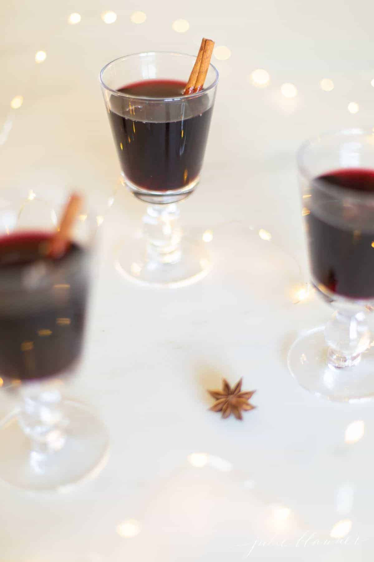 Three clear glasses full of warmed mulled wine for an easy Thanksgiving Recipe