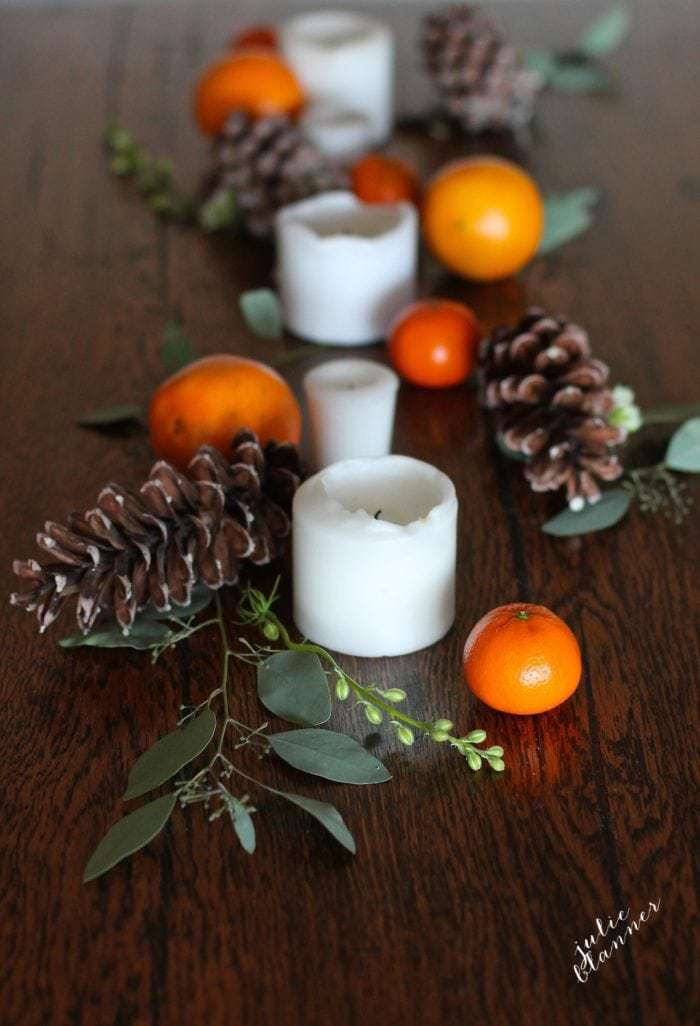 a simple pinecone and orange fall centerpiece